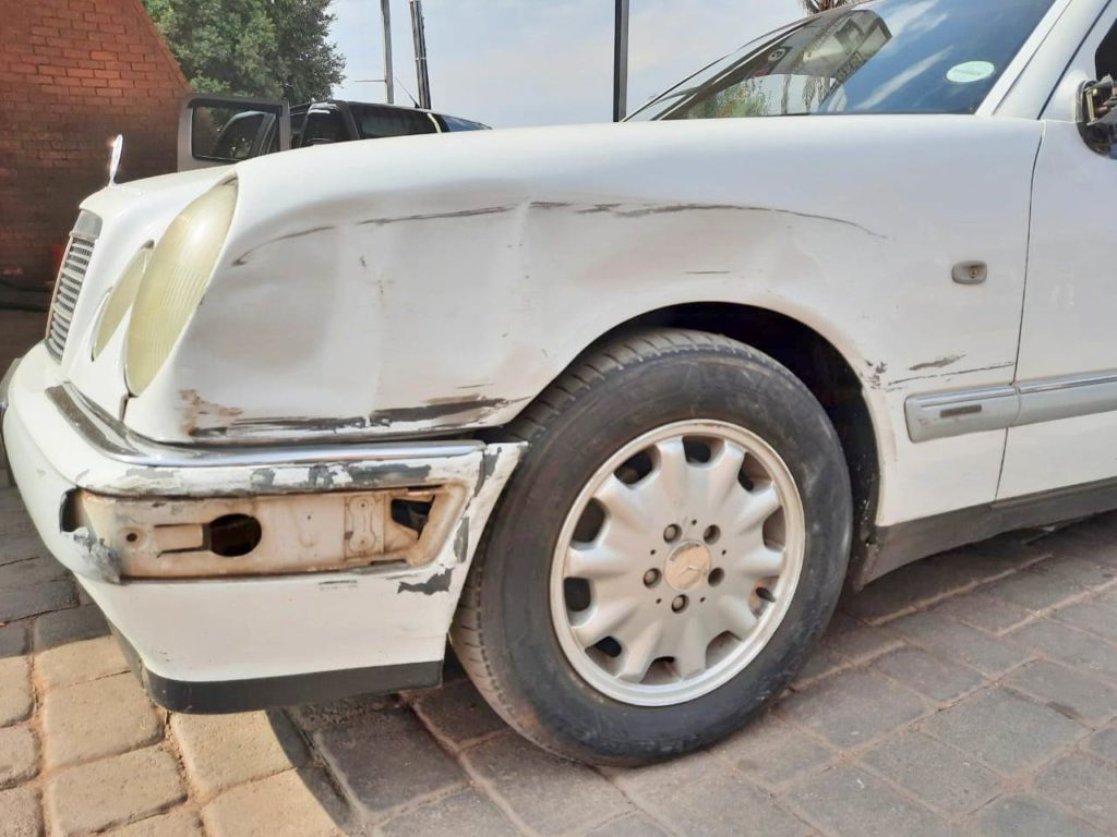 The damaged car of Muhammad Munir, after chasing and bumping the getaway vehicle of the thugs, while trying to stop them.